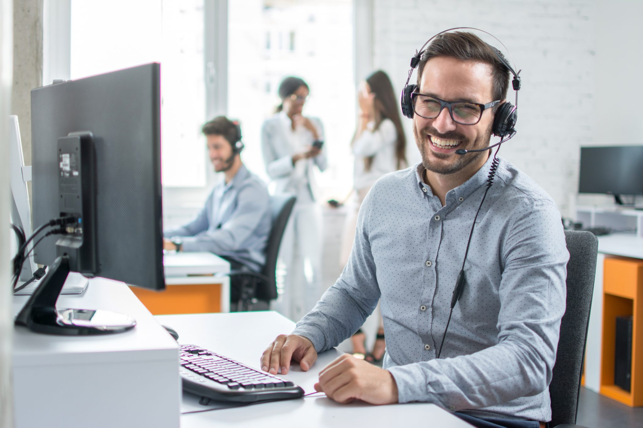 Transcriptionist smiling and wearing headphones on contact us page